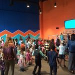 Kids are worshipping in Kid Village - learning about Jesus and having fun!