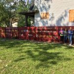 Volunteers from The Village Christian Church in MInooka, IL painted Bible verses and inspirational messages on fences in the community of Roseland in Chicago