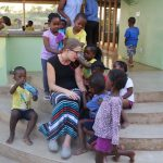 The kids at Heart for Africa love hanging out with volunteers from The Village Christian Church.