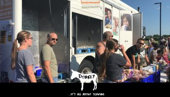 The people are getting off their donkey to help others at The Village Christian Church in MInooka, IL