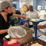 The Village Christian Church in Minooka, IL packs meals for the hungry around the world.